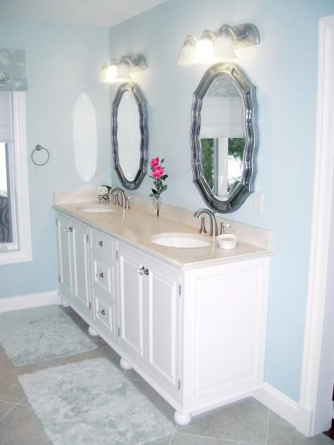 Bun feet give this built-in bathroom vanity the feel of a ...