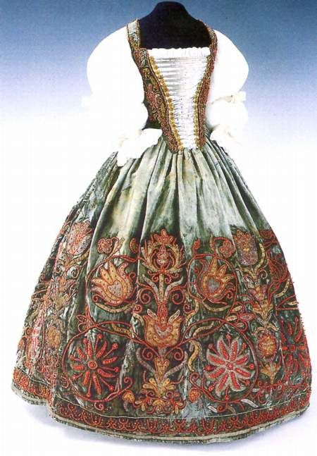 "Hungarian women's dress from the 16-17th century.  You can see the ancient symbol called "" Tree of life"" in the embroidery."