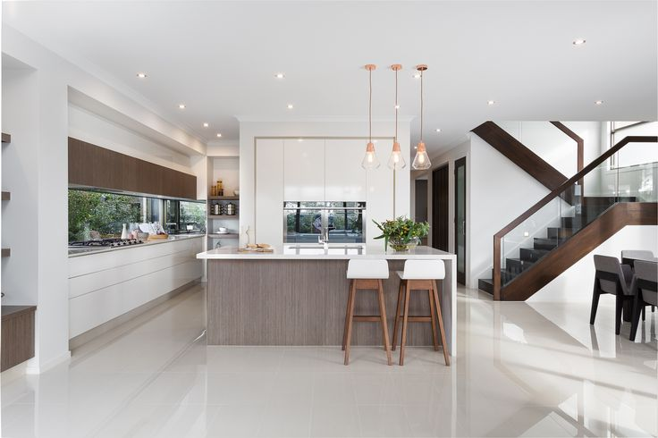 KITCHEN: Walnut timbers are the key to grounding this kitchen design as well as adding a textural element to the smooth of white tones. Pair this with delicate marble features and copper highlights to create contemporary elegance at its best. Visit Minerals on our Lookbook here: http://www.metricon.com.au/get-inspired/lookbook/minerals