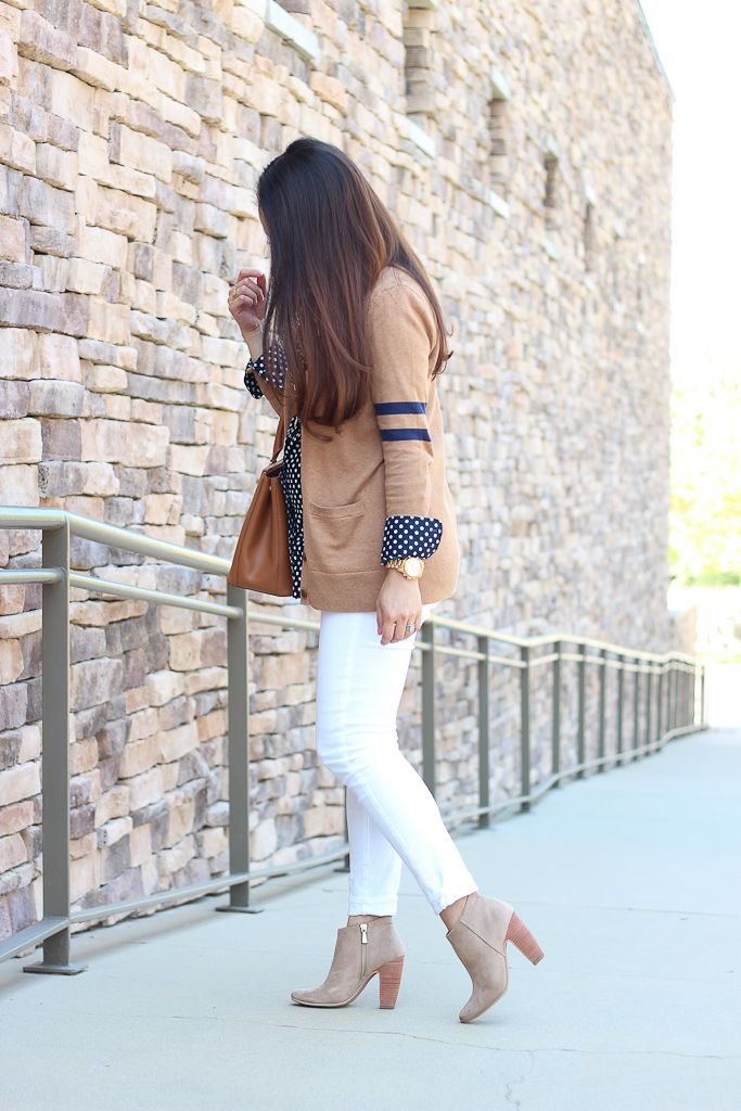 StylishPetite.com | Collegiate v-neck cardigan, Paige Denim verdugo cropped white jeans, ankle suede booties, navy polka dot shirt, camel purse, Fall outfit, Fall fashion, petite outfit