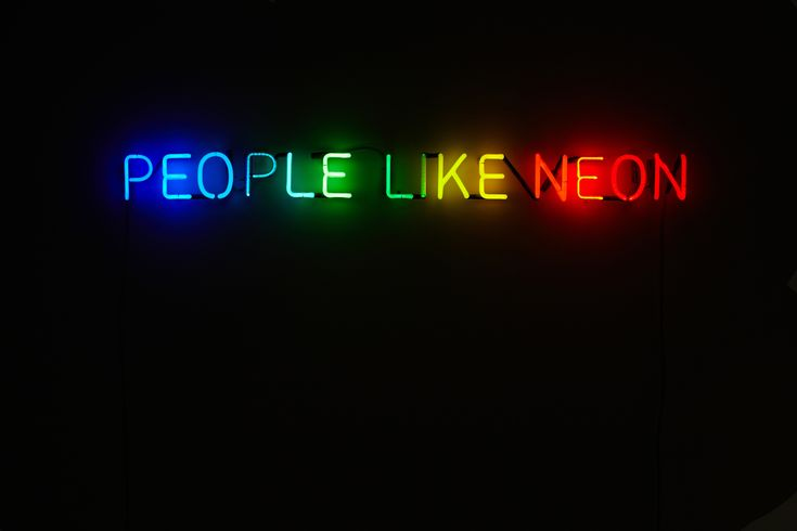 """People Like Neon - Peter Saville: Images of the neon piece designed by Peter Saville, creating a limited edition double sided poster. Commissioned by Neon Workshops."" -- Some people really like rainbow-colored neon art!"