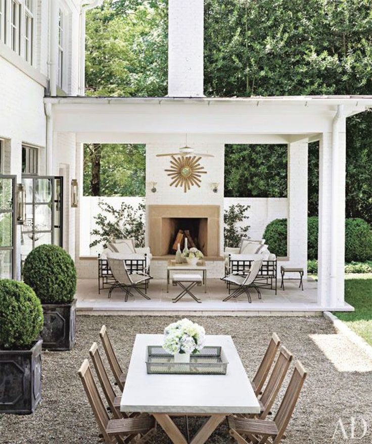 Transitional Outdoor Fireplace & Living Area Architectural Digest