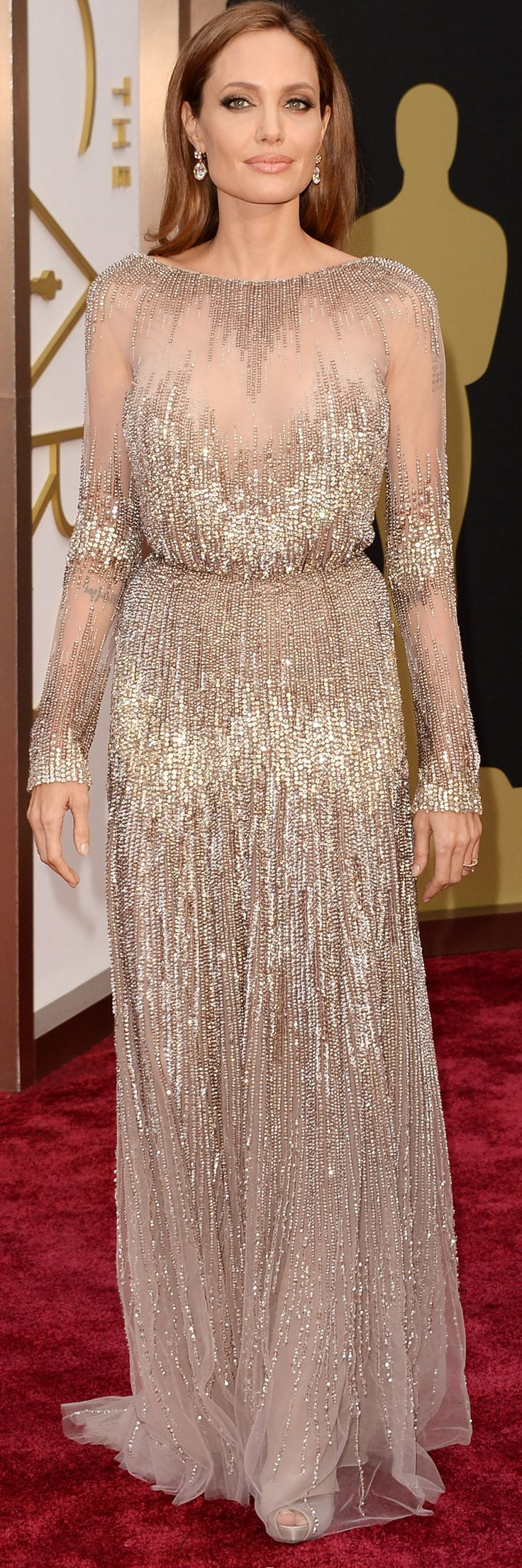 Angelina Jolie in a sparkling and sheer Elie Saab dress on the red carpet at the Academy Awards. #oscars