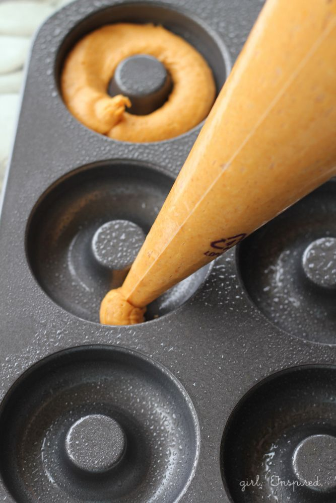 Use piping bag to add batter to donut pan - Two Ingredient Pumpkin Donuts!