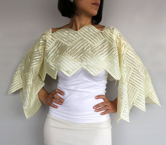 This bridal shrug, shawl, bolero, poncho, dress cover-up is made with geometrical, losange patterned satin embroidered tulle fabric in ivory color. With seamless, easy-to-use design, its tied with thin satin ribbons under the sleeves. Ideal as bridesmais dress cover ups. Due its