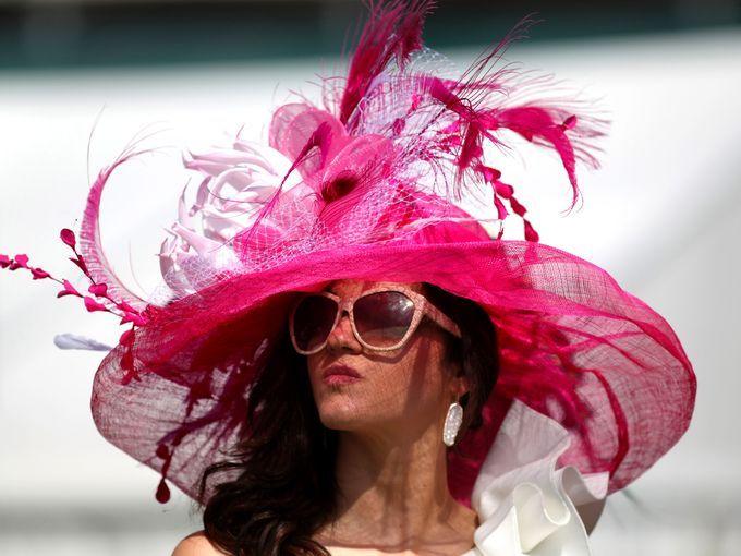 Fan Ellen Palmer wears a derby hat in the infield.