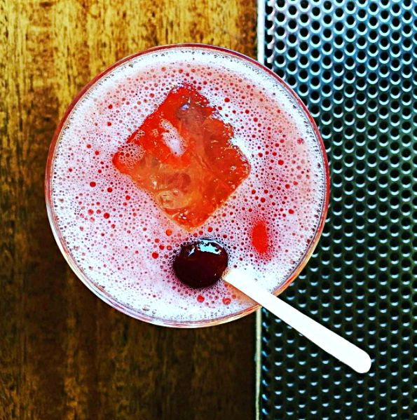 You'll find this Cherry Bounce cocktail when you explore the Barbary Coast on this Sidewalk. The Cherry Bounce cocktail is one of Comstock's fan favorites (it's bourbon based with fresh lemon juice, brandied cherry juice, bitters, and champagne). This walk has seven stops: 1. The Old Ship Saloon 2. Gold Street 3. Hotaling Place 4. Taverna Aventine 5. Comstock Saloon 6. City Lights Booksellers & Publishers 7. The Saloon