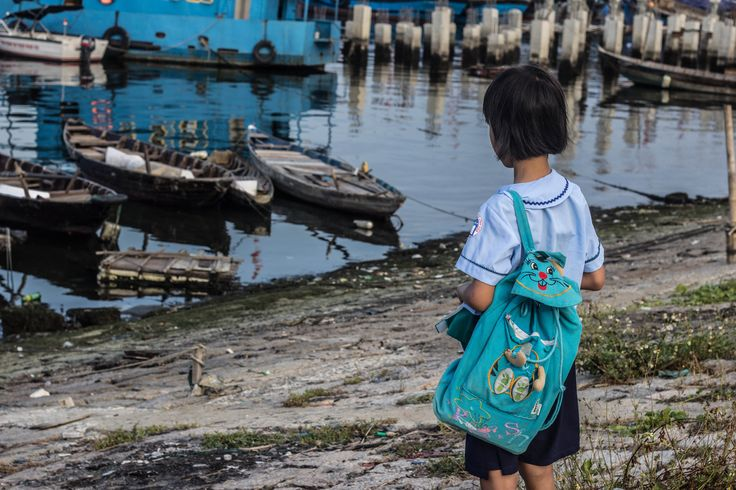 DaNang City, Vietnam - A young girl awaits the return of her parents who work 12 hours a day fishing for roughly $5 per day
