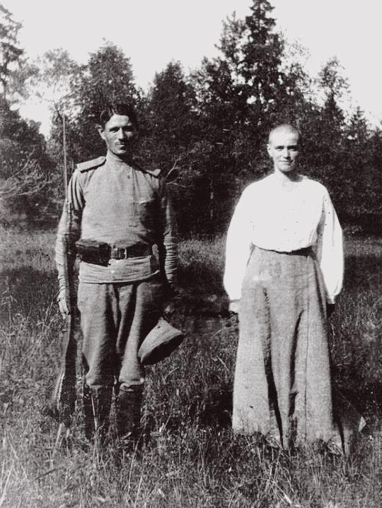 """Grand Duchess Maria Nikolaevna under house arrest with one of the guards, Tsarskoe Selo 1917 """