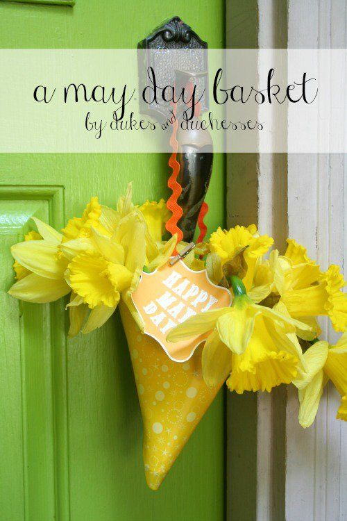 an upcycled may day basket made from a paper party hat