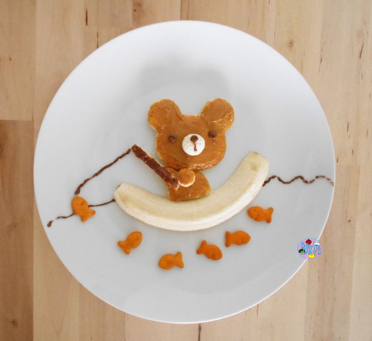 Best was cut with shape cutter & spread with peanut butter. Details are done in Nutella & boat is 1/2 a banana w/ gold fish crackers