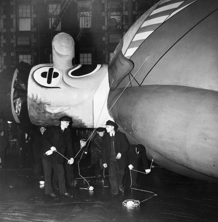 In preparation for a Macy's Thanksgiving Day parade in the early 1940s, balloon handlers hold the ropes of a clown filled with helium gas. Photo: Weegee(Arthur Fellig)/Internatio, Getty Images / ICP