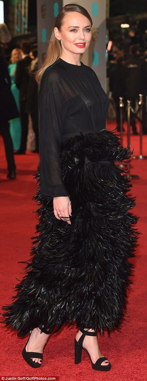 Even her toenails are black! Laura Haddock goes for a total black-out