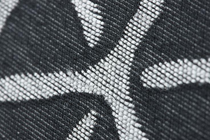 Textured jacquard fabric wallcovering.