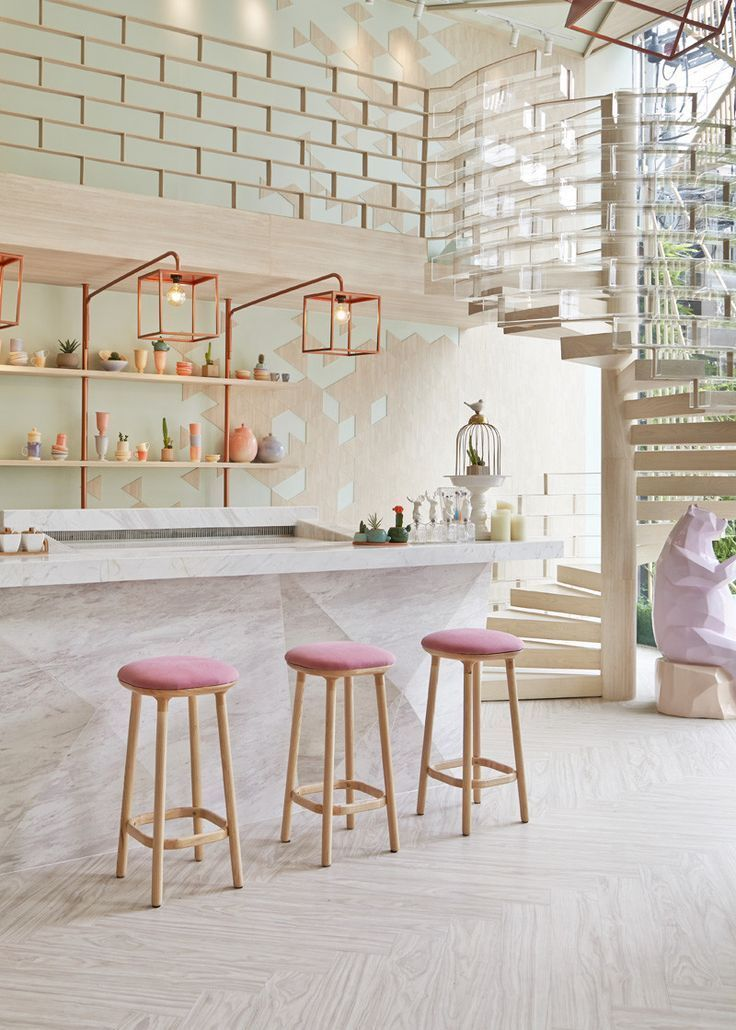 I LOVE this beautiful pastel pink + copper bar! - The marble effect bar, the wooden textured floor, the brick pattern railings + the geometric patterned walls = Love!