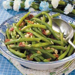 (Use nitrate-free turkey bacon) Bits of bacon and onion dress up the green beans in this easy-to-prepare side dish.