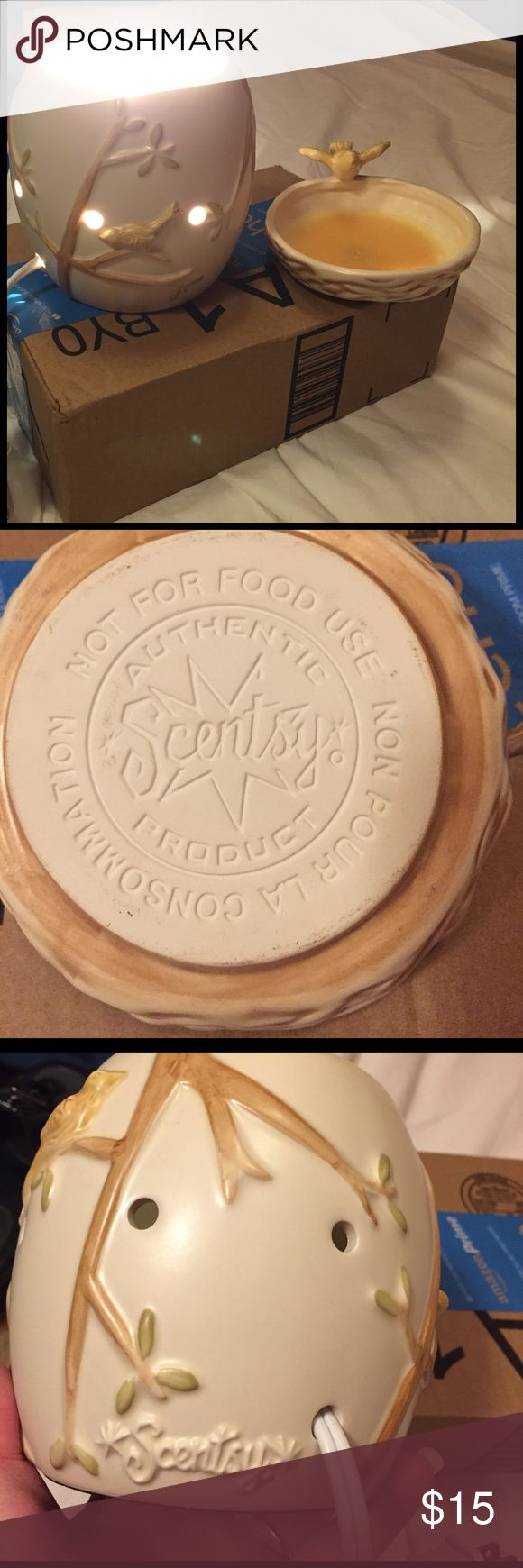 """Scentsy brand wax warmer w/on/off switch & wax Scentsy brand wax warmer (has wax in it), but only used a short time. Has on/off switch & takes a night light bulb. Bulb is not included, as I don't have one to replace it. I used a larger bulb to show it does work. Includes 2 wax melts. They are labeled as very sexy heavenly scent. They have a flowery smell, but they do smell wonderful. Wax melts are not scentsy brand. I have another warmer that I use, I don't need this one. 6"""" tall & 5"""" wide…"""