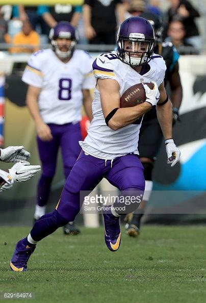 News Photo : Adam Thielen of the Minnesota Vikings runs after...