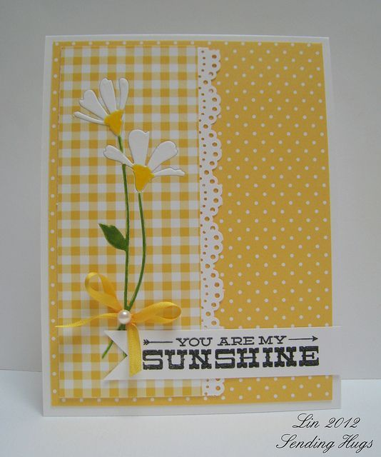 lively yellow and white card...like the mix of two patterns, polka dots and gingham..lovely daisy die cuts too...: