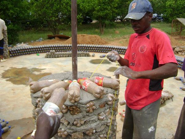 Plastic Bottles Filled with Sand - 20 Times Stronger than Bricks - One Nigerian community has found a way to recycle soda bottles and build with affordable building materials. 500 million bottles are discarded in Nigeria every year. Talk about Sustainable Design!