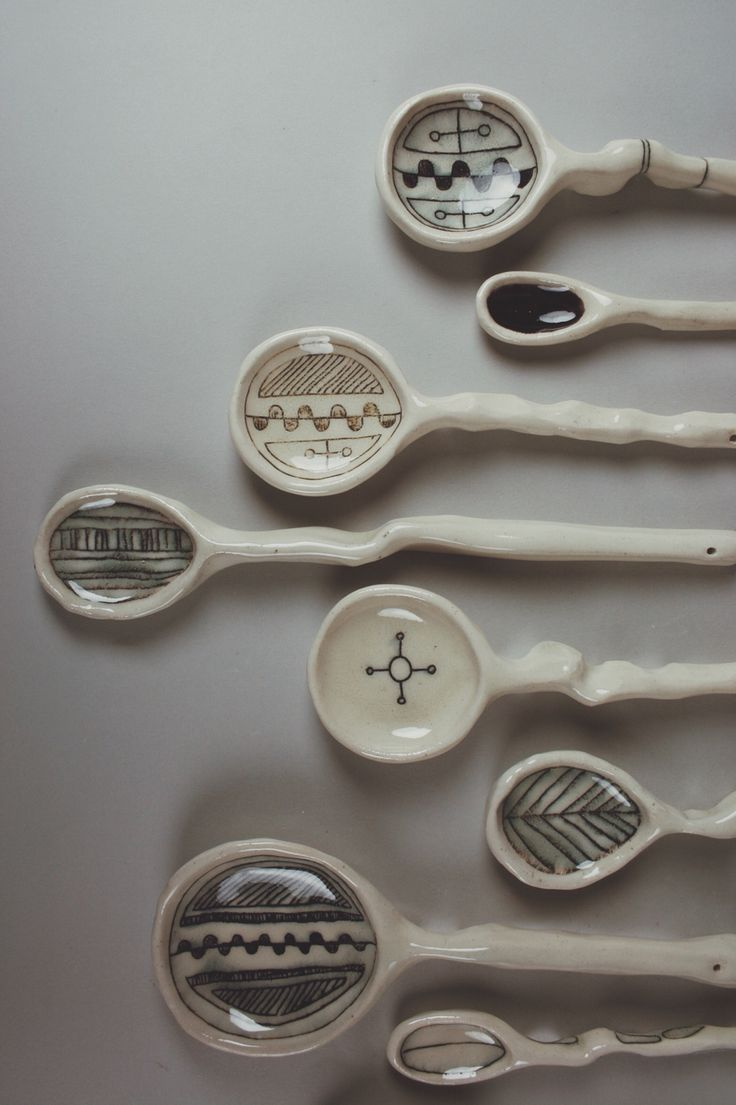 ashley.e.young ceramics hanging wall spoons  IG: ashleyeyoung #handmade #ceramics #spoons