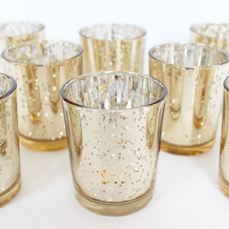 Wedding Decoration Votive Candle Holder in Gold - SOLD BY DOZEN - 2.25in. X 2.5in.  Perfect wedding decorations that add a stunning look to your wedding table décor with these David Tutera™ mercury glass votive candle holders in spotted gold. 12 votives per pack.  #afloral