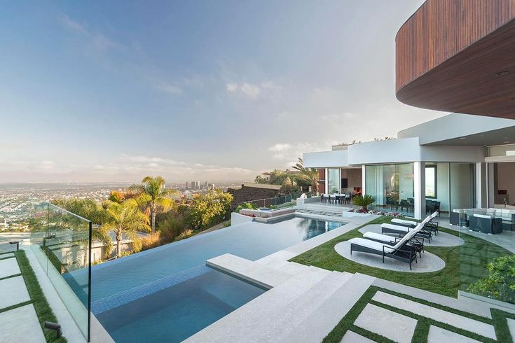 LA Residences   Perched atop the Sunset Strip's most coveted Bird Street, Nightingale, this magnificent modern has all the elements befitting this grand location. Voluminous rooms. custom woods and fire and water elements create a warmth rarely seen in modern architecture. #LAhomes #LAresidences #modernarchitecture