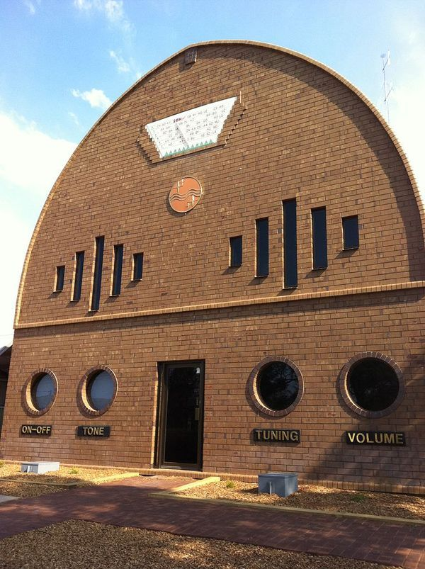 In Broken Hill, New South Wales, is a brick building constructed like an old timey radio, with round windows on the first level marked for tuning and volume. It serves as the headquarters for Radio 2BH studios.