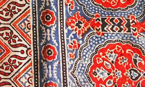 Ajrak printing is a distinguished form of woodblock printing that originated in the present-day province of Sindh, Pakistan and neighbouring Indian districts of Kutch in Gujarat and Barmer in Rajasthan.