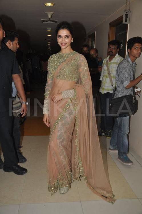 Deepika Padukone is seen here at the music launch of her Farah Khan film, 'Happy New Year'. Deepika, along with her co-stars Shah Rukh Khan, Abhishek ...