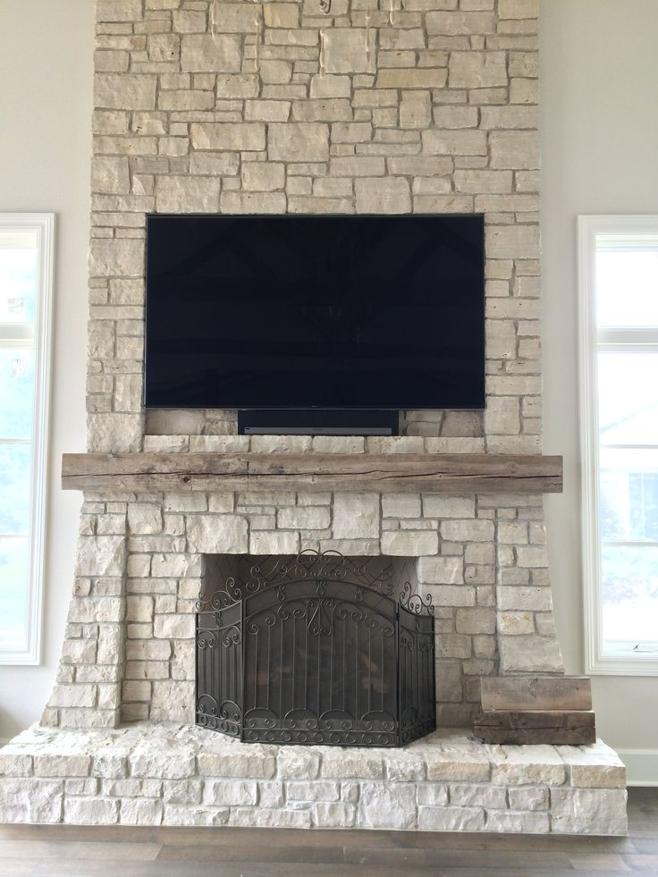 Flat Panel Tv Mounted And Inset Into Stone Facade Over A
