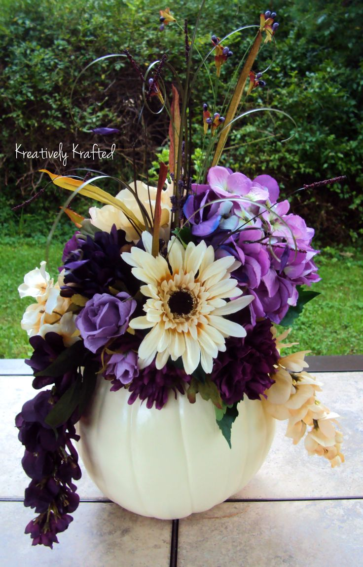 White pumpkin filled with plum purple & cream colored flowers. Fall Autumn wedding centerpiece table arrangement. https://www.etsy.com/shop/KreativelyKrafted