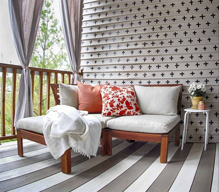 Make an outdoor seating deck feel like an extension of your living room with comfy textiles and mixed patterns   Jamie's house, USA