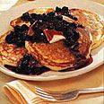Whole wheat oatmeal pancakes...substitute the buttermilk with yogurt and brown sugar with evaporated cane juice
