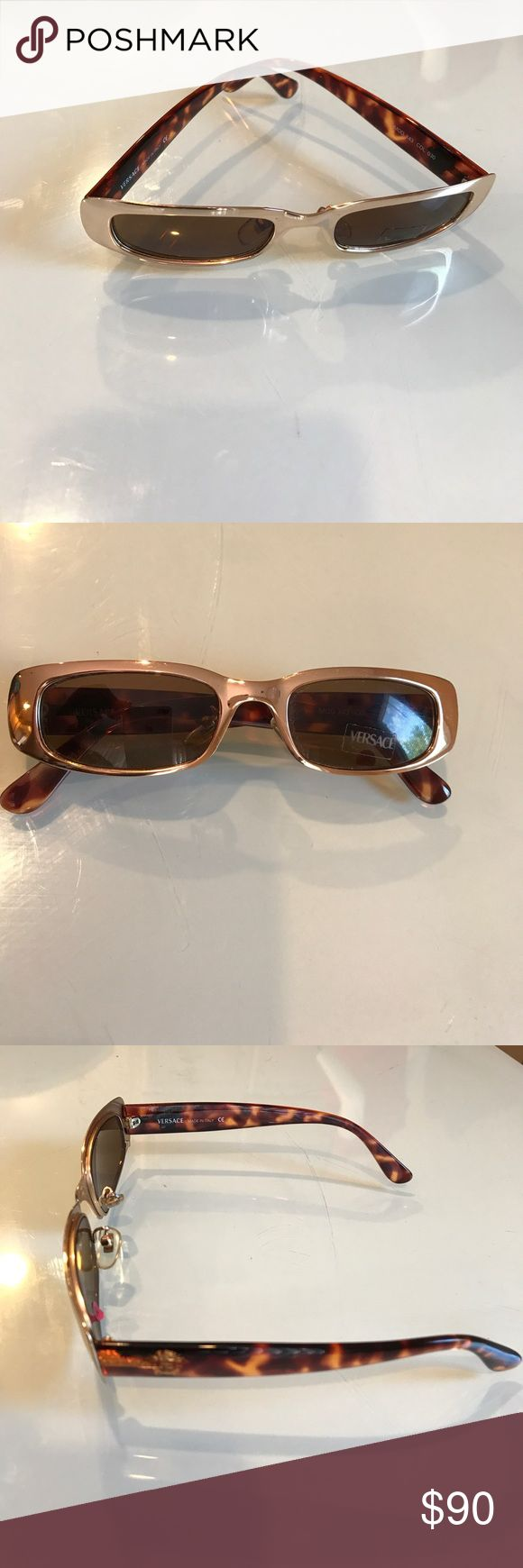 Versace Sunglasses Never Worn Excellent Condition Versace Sunglasses Never Worn Excellent Condition gold frame with turquoise shell arms. No scratches on eye glass lens. Designer Versace sticker still on frame. Versace designer emblem on arms of Sunglasses. Versace named engrave inside sunglasses. Versace Accessories Sunglasses