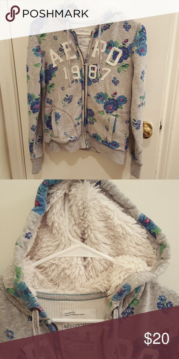 Aeropostale floral zip up hoodie Good condition. Fuzzy hoodie! Blue floral print and waffle thermal internal. Aeropostale Jackets & Coats