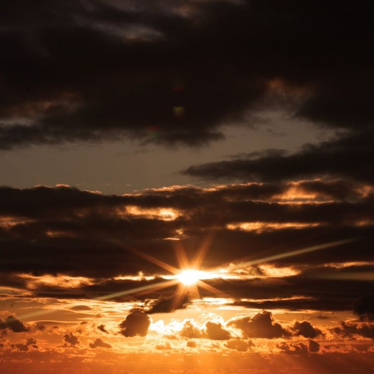 the sun through clouds