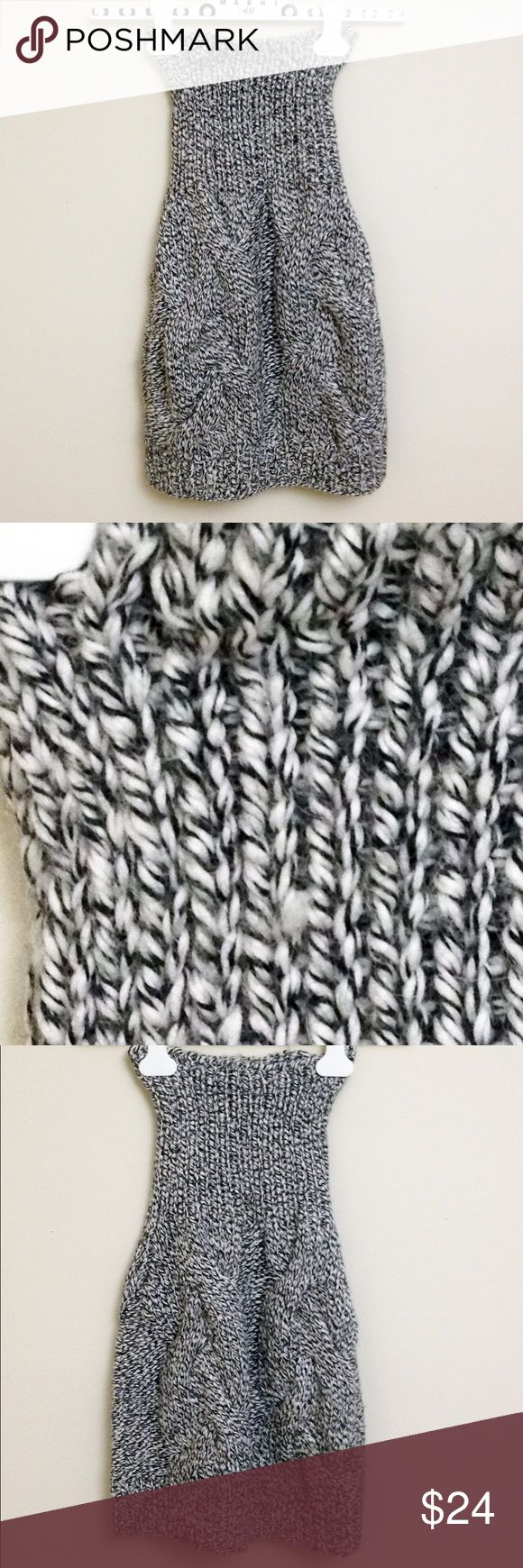H&M TREND Chunky Braided Cable Wool Knit Skirt H&M TREND chunky black and white Braided Cable wool knit skirt with a high-waisted Fisherman's Rib stitch. 23 in. long; could also be worn as a top. A little snag on the right on the waist. No-light wear. Made in China. 60% acrylic, 40% alpaca. Machine wash in wool program or hand wash cold with mild detergent. Only non-chlorine bleach. Dry flat. Medium iron or dry clean. H&M Skirts Mini