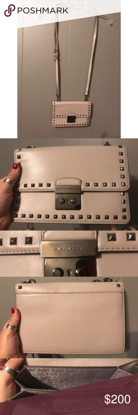 """MICHAEL MK Sloan Studded Gusset Cross Body- Large Brand new- with tags. MICHAEL Michael Kors Large Sloan Studded Gusset Leather Cross Body in the Color: Cement. Large sized bag; 9""""W x 6""""H x 1""""D Interior features lining, 3 gusseted pockets, 1 zip pocket and 6 card slots 21-1/4"""" to 25-1/4""""L adjustable crossbody strap Push-lock closure Exterior features gunmetal hardware, studded accents and 1 back pocket Silhouette is based off 5'9"""" model Leather; lining: polyester Michael Kors Bags Crossbody…"""