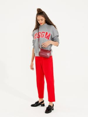 grey sweatshirt with MSGM logo in red on front from Fenwick, red trousers Monki, black slip open backed brogue shoes Senso, red cross the body bag Reiss