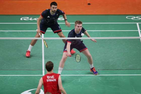 Marcus Ellis (GBR) and Chris Langridge (GBR) compete against Denmark during the men's doubles in the... - David E. Klutho-USA TODAY Sports