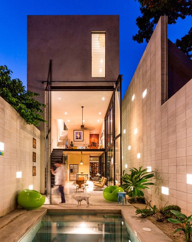 www.terenceproperties.com  #terenceproperties taller estilo installs double height glass doors to concrete dwelling in mexico city