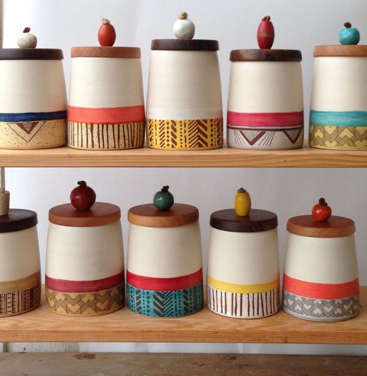 These ceramic containers are thrown on the wheel. They are fired several times to layer the colour and print. The lids are made by a local wood-worker; they're turned from reclaimed fir and walnut. They're finished with a handmade ceramic or vintage wooden handle.