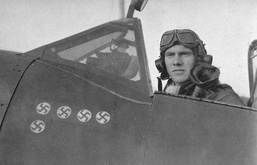 Norwegian fighter pilot Martin Gran (1917 - 2004) of No. 332 Squadron in the cockpit of a Supermarine Spitfire.