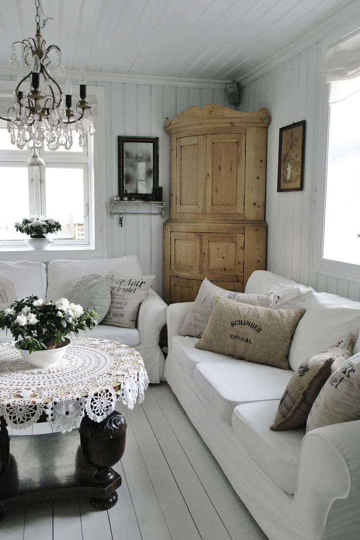 Cottage style living room. Love the white walls, ceiling, couches with the wood furnishings