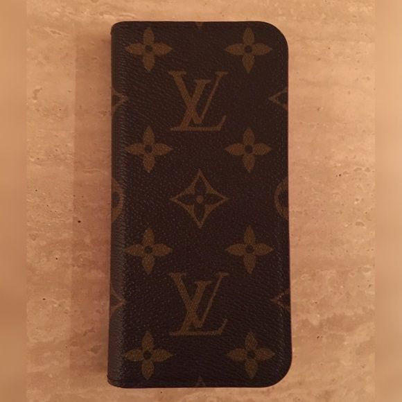 """Louis Vuitton iPhone 7 Case Authentic. Comes with box. Monogram LV pattern with hot pink inside. 2 card/ money compartments. Your phone actually """"sticks"""" to the right side of the case. Surface is preserved and still """"sticky"""" Great condition- used for about 2 weeks. Great Holiday gift! Louis Vuitton Accessories Phone Cases"""