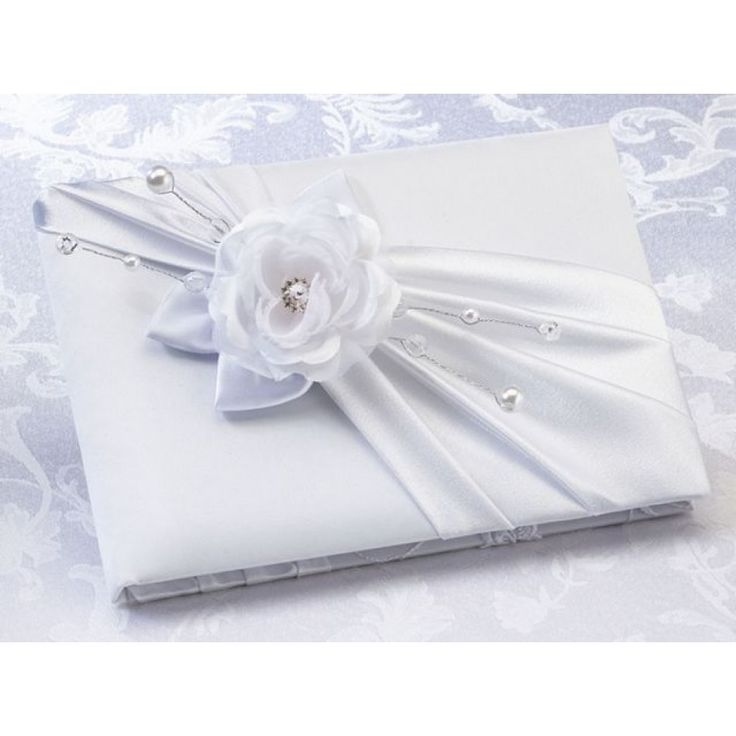 """The Satin Rose Guest Book is the perfect choice to impress your guests at your wedding event! This 8.5"""" x 6"""" guest book has a satin cover, and the front is decorated with a darker sash and a lighter colored rose. Beads attached to wires extend outward from the rose. A rhinestone and pearl decoration in the center of the rose completes the design. This elegant guest book holds 55 pages for a total of 990 signatures. Available in 2 colors, white or taupe.  #timelesstreasure"""