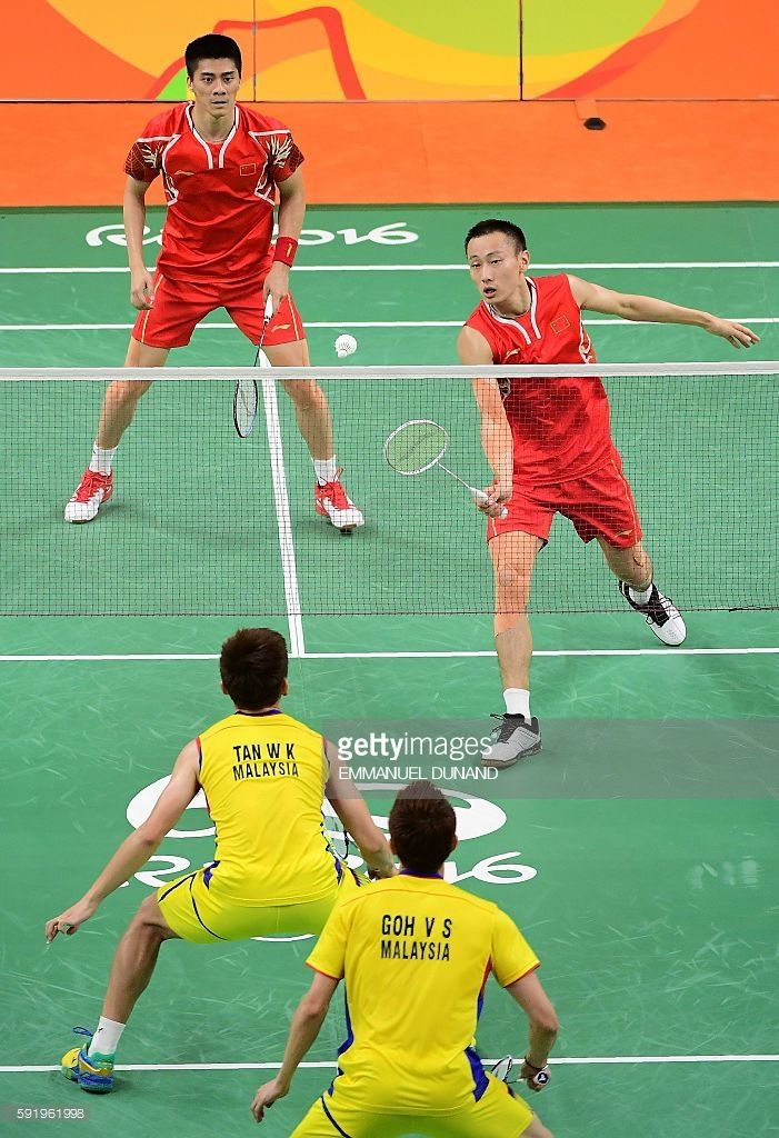 China's Zhang Nan (top R) and China's Fu Haifeng (top L) return against Malaysia's V Shem Goh (bottom R) and Malaysia's Wee Kiong Tan during their men's doubles Gold Medal badminton match at the Riocentro stadium in Rio de Janeiro on August 19, 2016, for the Rio 2016 Olympic Games. / AFP / EMMANUEL