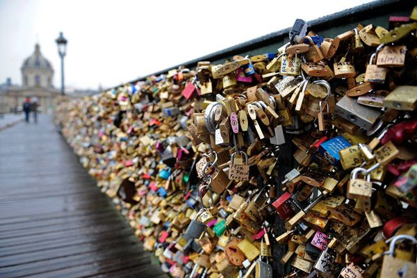SEE: Love Lock Bridge // Located on the Pont des Arts footbridge over the Seine in central Paris sits the most famous bridge in Paris. Typically the sweethearts from around the world lock a padlock to the bridge with their names or initials are inscribed on the padlock, and its key is thrown away to symbolise unbreakable love.