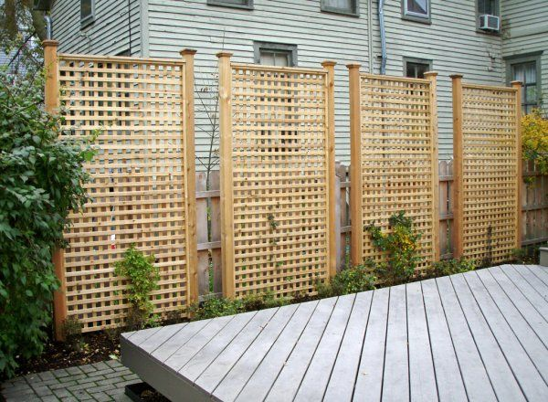 tall rectangular cedar lattice privacy panels.